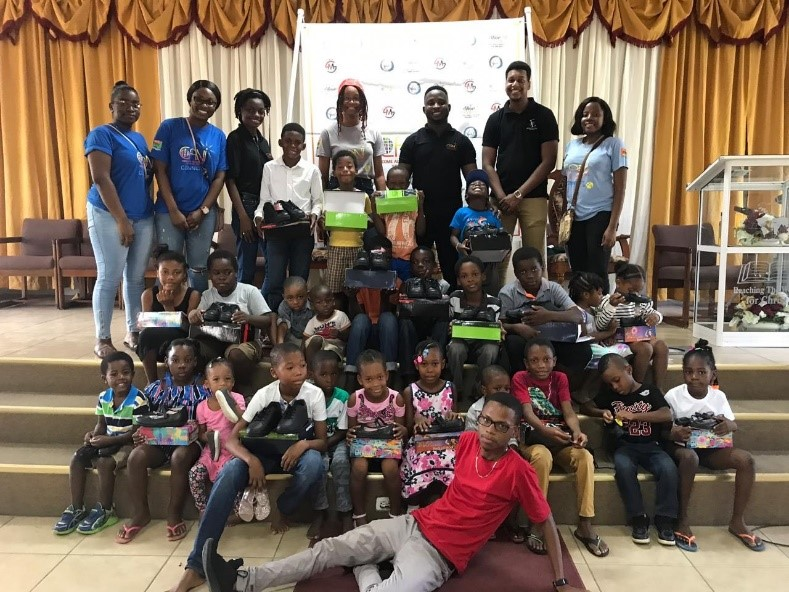The Global Edge Guyana Gives Back by CANI Shoe Drive